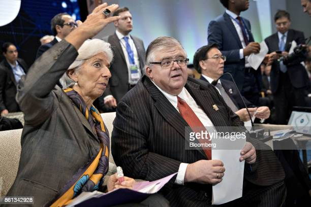 Agustin Carstens governor of the Bank of Mexico center speaks with Christine Lagarde managing director of the International Monetary Fund during an...