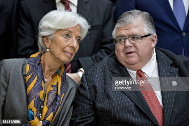 Agustin Carstens governor of the Bank of Mexico right speaks with Christine Lagarde managing director of the International Monetary Fund during an...