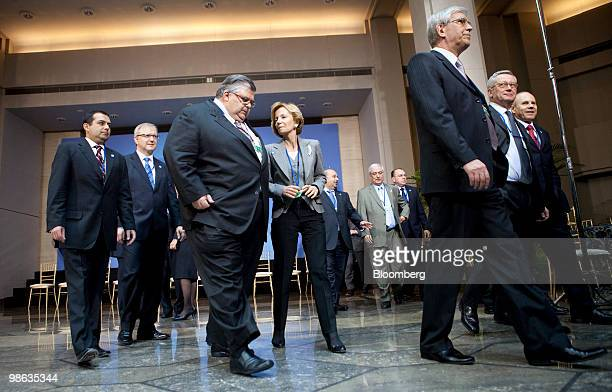 Agustin Carstens governor of the central bank of Mexico center left talks to Elena Salgado Spain's finance minister after a group photo during the...