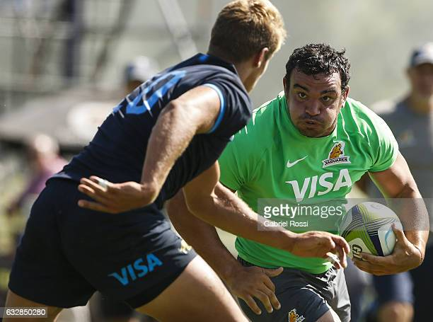 Agustin Creevy of Jaguares is tackled by Domingo Miotti of Argentina XV during a friendly match between Jaguares and Argentina XV as part of Jaguares...