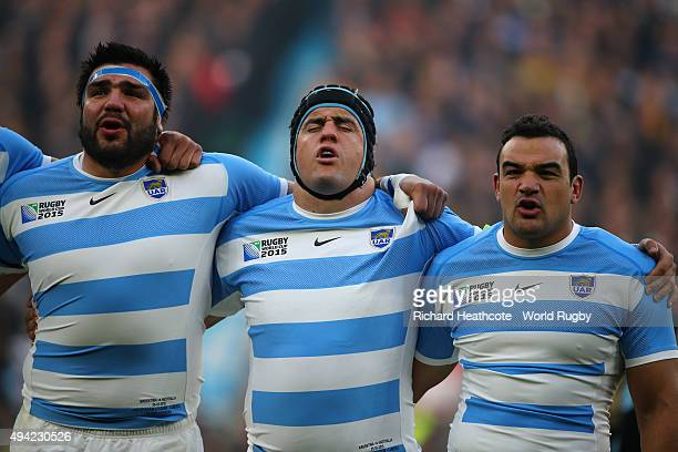 Agustin Creevy sings the national anthem with Marcos Ayerza and Ramiro Herrera of Argentina during the 2015 Rugby World Cup Semi Final match between...