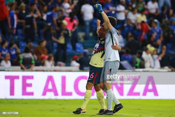Agustin Marchesin and Miguel Samudio of America celebrate during the 13th round match between Cruz Azul and America as part of the Torneo Apertura...