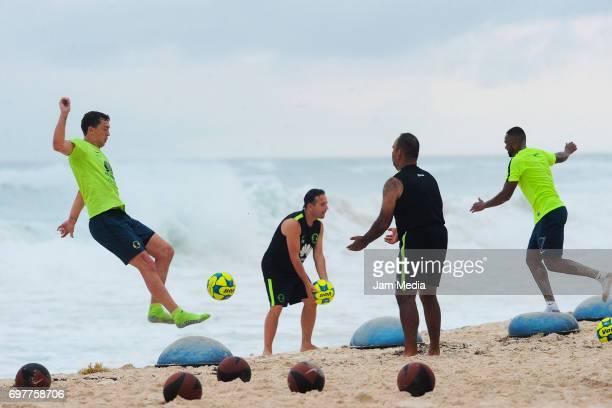 Agustin Marchesin and Renato Da Silva of America trains in the sand during the Pre Season training for the Torneo Apertura 2017 Liga MX at Playa del...