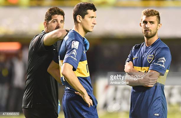 Agustin Orion Gino Peruzzi and Guillermo Burdisso of Boca Juniors await while a second leg match between Boca Juniors and River Plate is delayed due...