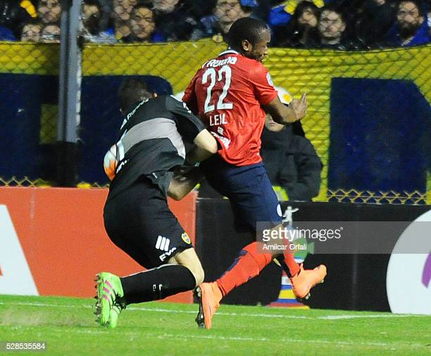 Agustin Orion goalkeeper of Boca Juniors crashes into Luis Leal of Cerro during a second leg match between Boca Juniors and Cerro Porteno as part of...