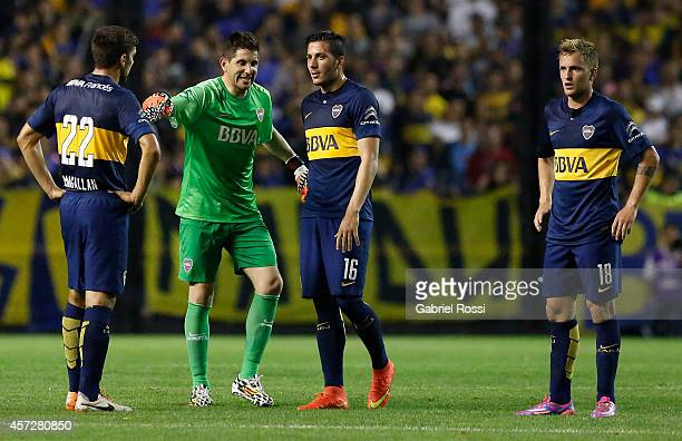 Agustin Orion goalkeeper of Boca Juniors gives instructions to his teammates Lisandro Magallán Gonzalo Castellani and Nicolás Colazo during a match...