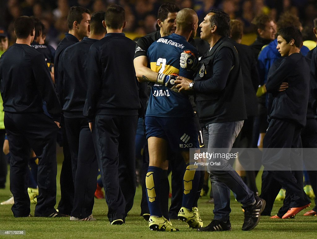 <a gi-track='captionPersonalityLinkClicked' href=/galleries/search?phrase=Agustin+Orion&family=editorial&specificpeople=2498311 ng-click='$event.stopPropagation()'>Agustin Orion</a> goalkeeper of Boca Juniors holds Daniel Diaz of Boca Juniors after a match between Boca Juniors and San Lorenzo as part of 23rd round of Torneo Primera Division 2015 at Alberto J. Armando Stadium on September 06, 2015 in Buenos Aires, Argentina.