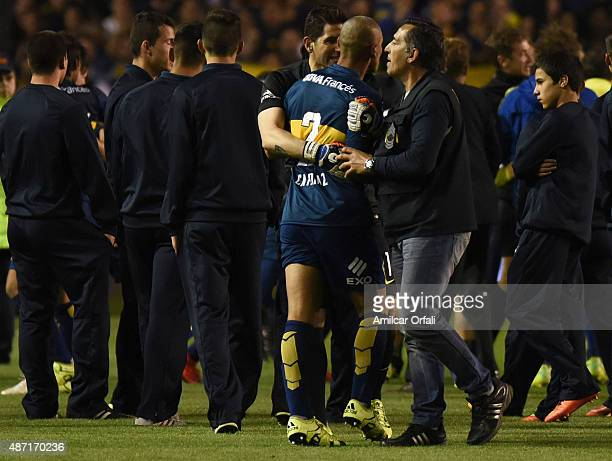 Agustin Orion goalkeeper of Boca Juniors holds Daniel Diaz of Boca Juniors after a match between Boca Juniors and San Lorenzo as part of 23rd round...