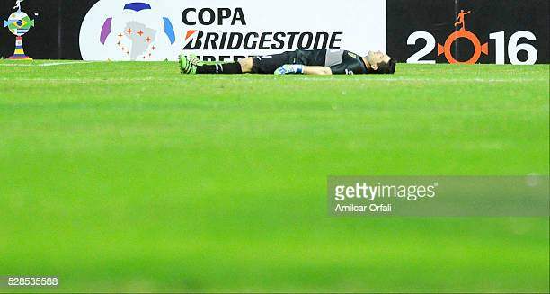 Agustin Orion goalkeeper of Boca Juniors is knocked out during a second leg match between Boca Juniors and Cerro Porteno as part of round of sixteen...