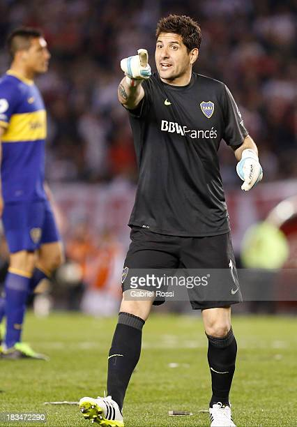 Agustin Orion of Boca Juniors gestures to the lineman during a match between River Plate and Boca Juniors as part of the Torneo Inicial 2013 at the...