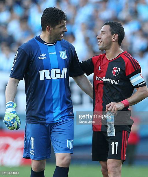 Agustin Orion of Racing Club and Maximiliano Rodriguez of Newell's Old Boys greet each other during a match between Racing Club and Newell's Old Boys...
