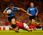 Agustin Ormaechea of Uruguay is tackled by Liam Williams of Wales during the 2015 Rugby World Cup Pool A match between Wales and Uruguay at...