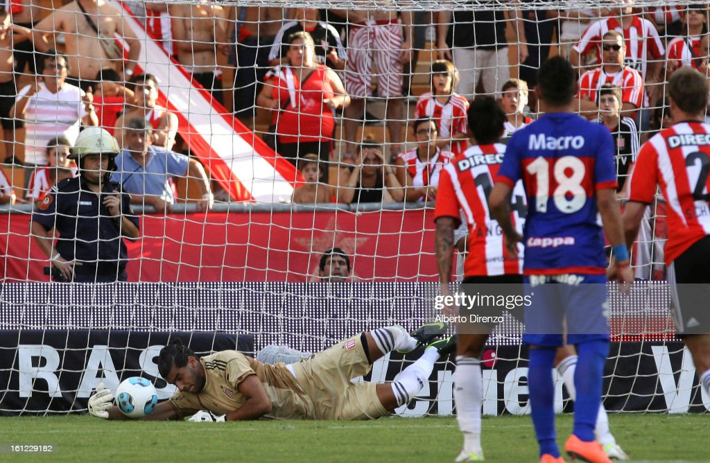 Agustin Silva stops a penalty kick to Gaston Diaz during a match between Estudiantes and Tigre as part of the 2013 Final Tournament on February 9, 2013 in La Plata, Argentina.