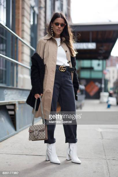 Agustina Marzari Bobbio is seen attending Carolina Herrera during New York Fashion Week wearing a black coat with camel jacket white sweater and navy...