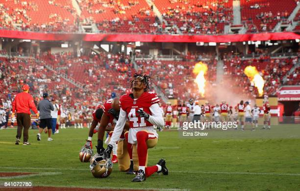 Ahkello Witherspoon of the San Francisco 49ers kneels before their game against the Denver Broncos at Levi's Stadium on August 19 2017 in Santa Clara...