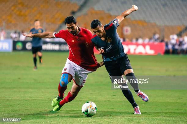 Ahly player Ahmed Fathi and Esperance player Anis during the CAF Champions League quarterfinal firstleg football match between Egypt's AlAhly and...