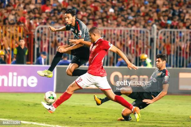 Ahly player Saad Samir middle of Sunsian players during the CAF Champions League quarterfinal firstleg football match between Egypt's AlAhly and...