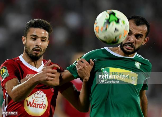 Ahly Tripoli's forward Bader Hassan Ahmed vies with Etoile du Sahel's Aymen Trabelsi during the African Champions league quarterfinal football match...