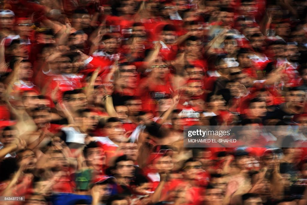 Ahly's fans cheer on their team during the CAF Champions League group B stage football match between Egypt's Al-Ahly and Ivory Coast's Asec Mimosas at the Borg el-Arab Stadium in Alexandria on June 28, 2016. / AFP / MOHAMED