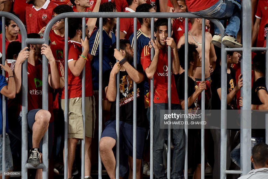 Ahly's fans cheer on their team during their CAF Champions League group B stage football match at the Borg el-Arab Stadium in Alexandria on June 28, 2016. / AFP / MOHAMED