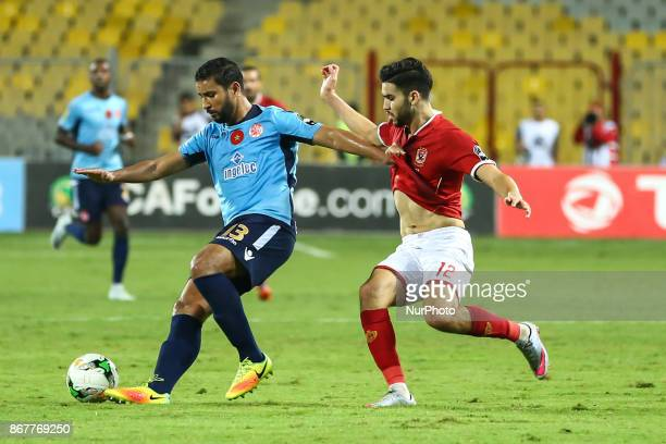Ahly's forward Walid Azaro vies for the ball with Wydad's Defender Rabeh Youssef during the CAF Champions League final football match between AlAhly...