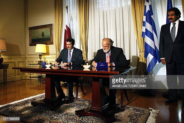Ahmad Al Sayed President of Qatar investment Fund and Dimitris Koutras CEO of Greek company AKTOR sign an investment agreement in the Greek...