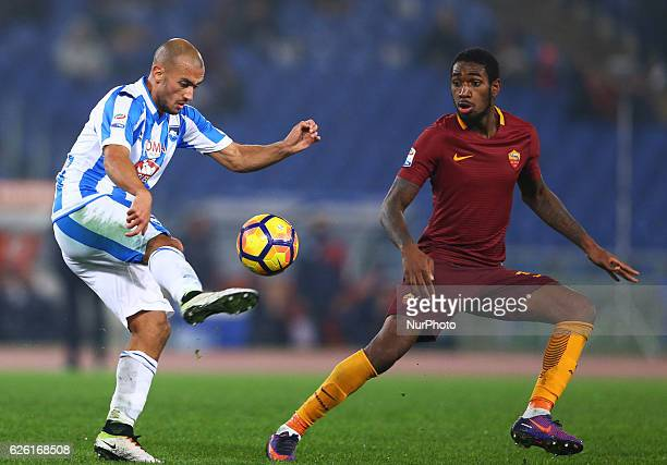 Ahmad Benali of Pescara and Gerson of AS Roma during the Serie A match between AS Roma and Pescara Calcio at Stadio Olimpico on November 27 2016 in...