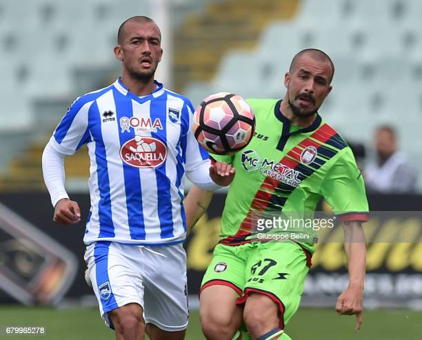 Ahmad Benali of Pescara Calcio and Bruno Martella of FC Crotone in action during the Serie A match between Pescara Calcio and FC Crotone at Adriatico...