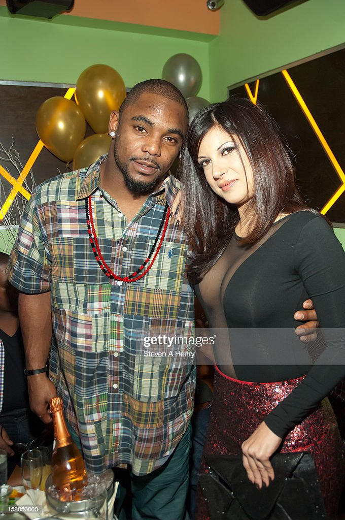 <a gi-track='captionPersonalityLinkClicked' href=/galleries/search?phrase=Ahmad+Bradshaw&family=editorial&specificpeople=2557220 ng-click='$event.stopPropagation()'>Ahmad Bradshaw</a> and Gia Jordan attend New Year's Eve 2013>> at Bamboo 52 on December 31, 2012 in New York City.