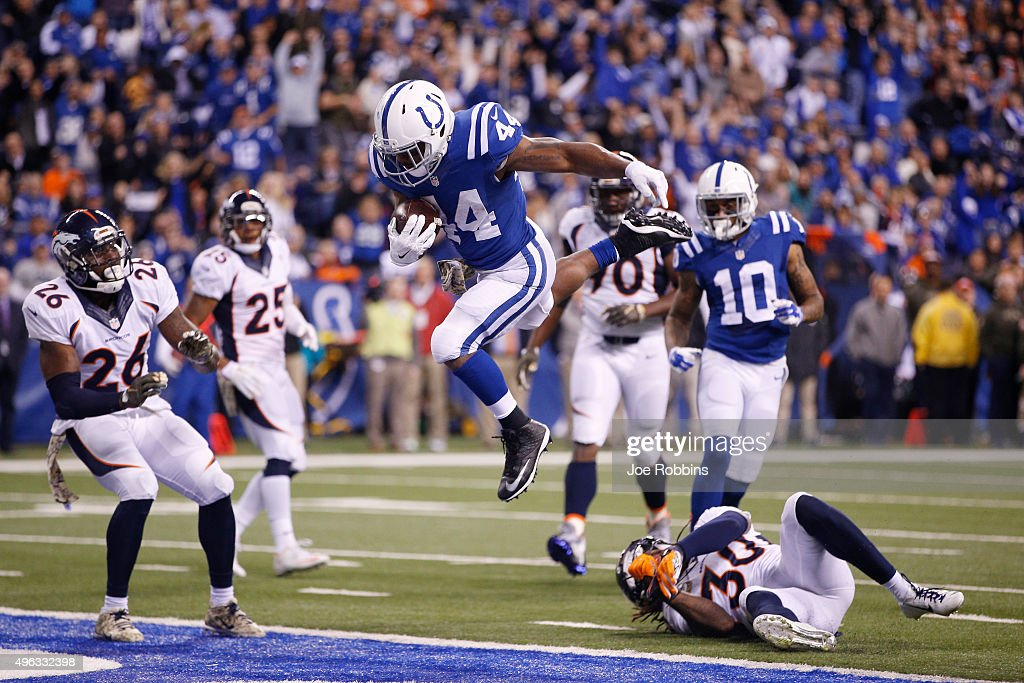 Ahmad Bradshaw #44 of the Indianapolis Colts leaps into the end zone with an eight-yard touchdown reception against the Denver Broncos in the fourth quarter of the game at Lucas Oil Stadium on November 8, 2015 in Indianapolis, Indiana.