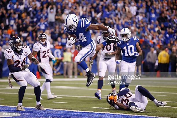 Ahmad Bradshaw of the Indianapolis Colts leaps into the end zone with an eightyard touchdown reception against the Denver Broncos in the fourth...