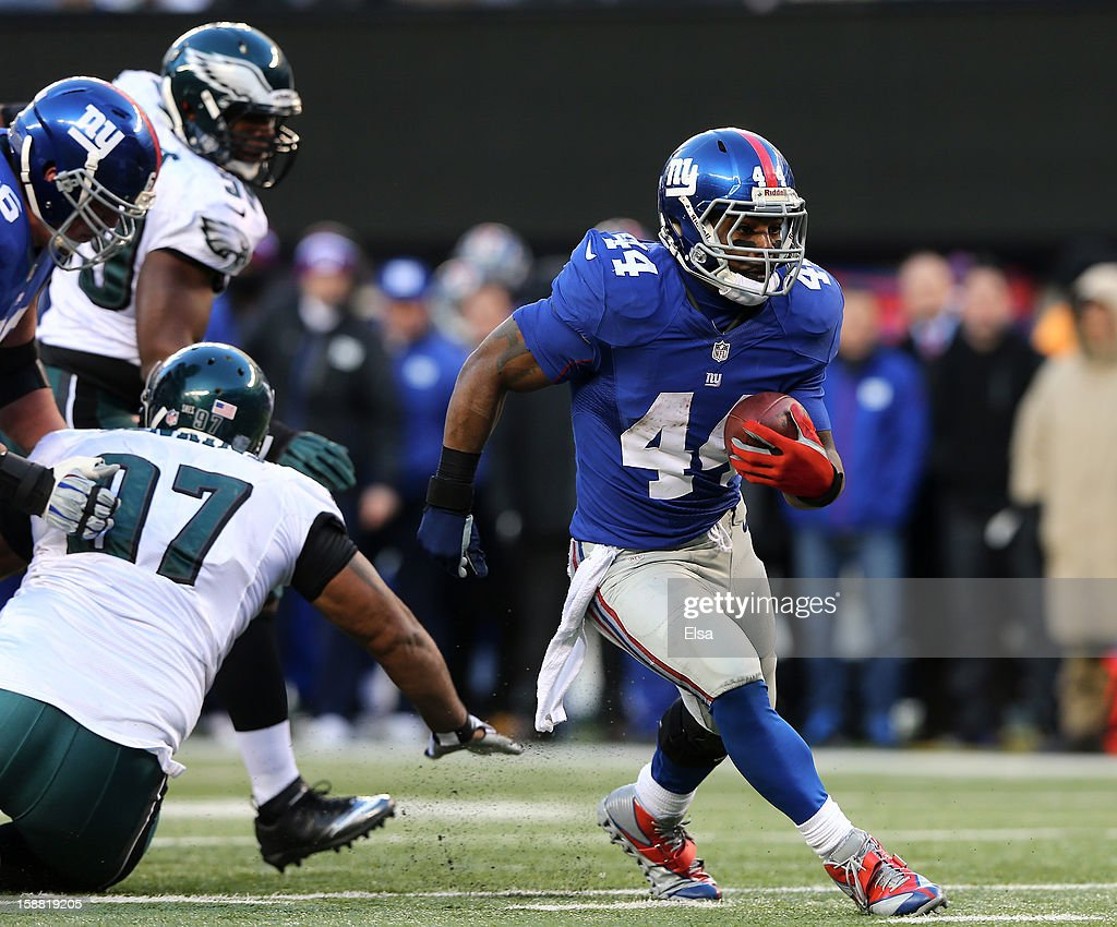 Ahmad Bradshaw #44 of the New York Giants carries the ball and avoids Cullen Jenkins #97 of the Philadelphia Eagles at MetLife Stadium on December 30, 2012 in East Rutherford, New Jersey. The New York Giants defeated the Philadelphia Eagles 42-7.