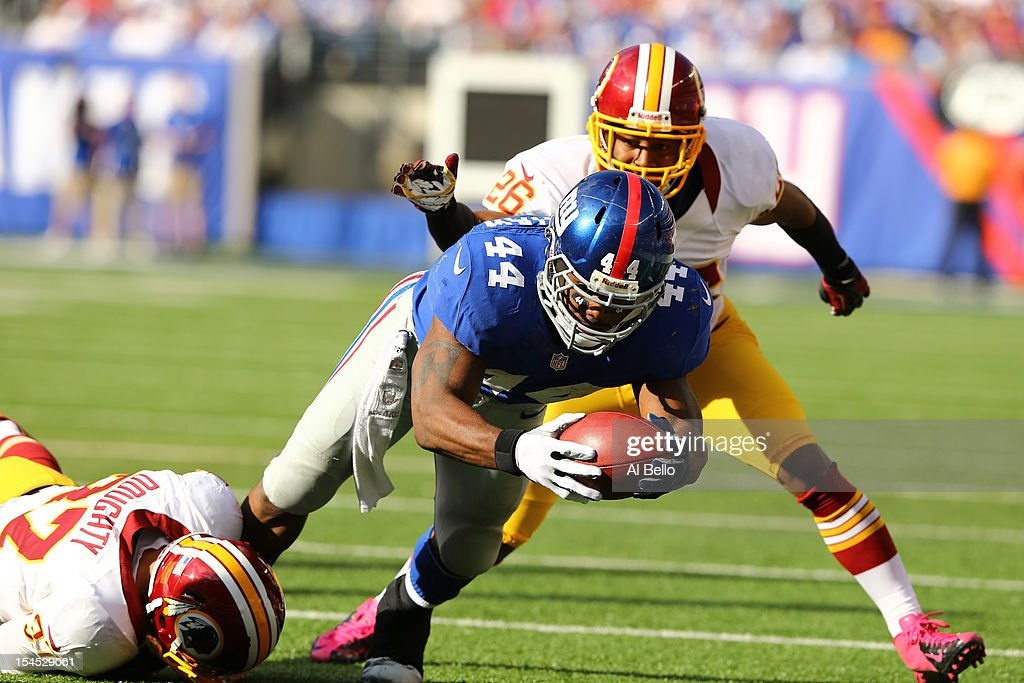 <a gi-track='captionPersonalityLinkClicked' href=/galleries/search?phrase=Ahmad+Bradshaw&family=editorial&specificpeople=2557220 ng-click='$event.stopPropagation()'>Ahmad Bradshaw</a> #44 of the New York Giants dives for a gain against Reed Doughty #37, and Josh Wilson #26 of the Washington Redskins during their game at MetLife Stadium on October 21, 2012 in East Rutherford, New Jersey.