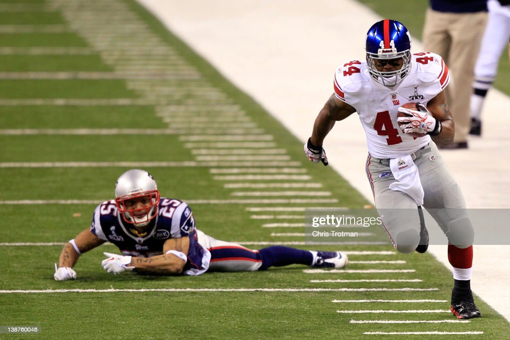 Ahmad Bradshaw #44 of the New York Giants runs with the ball against Patrick Chung #25 of the New England Patriots during Super Bowl XLVI at Lucas Oil Stadium on February 5, 2012 in Indianapolis, Indiana.