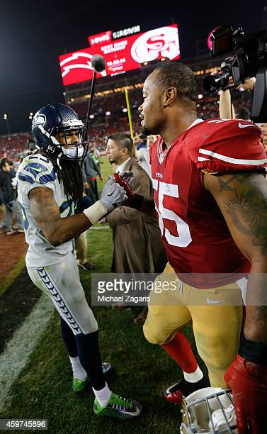 Ahmad Brooks of the San Francisco 49ers and Richard Sherman the Seattle Seahawks embrace on the field following the game at Levi Stadium on November...