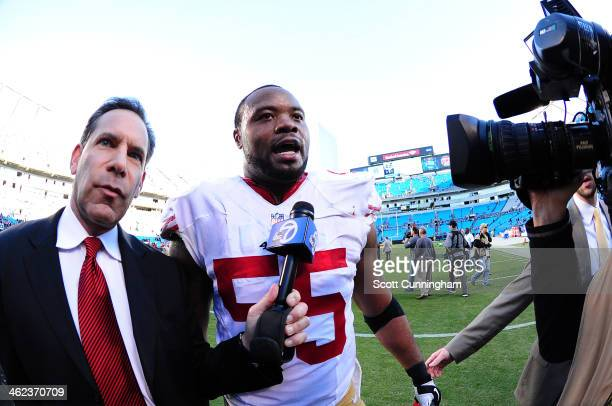 Ahmad Brooks of the San Francisco 49ers is interviewed after the NFC Divisional Playoff Game against the Carolina Panthers at Bank of America Stadium...