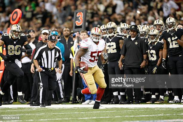 Ahmad Brooks of the San Francisco 49ers returns an interception during the game against the New Orleans Saints at the Superdome on November 17 2013...