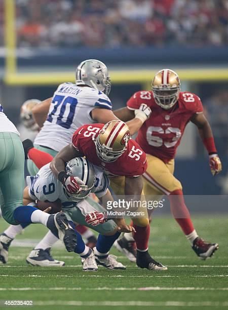 Ahmad Brooks of the San Francisco 49ers sacks Tony Romo of the Dallas Cowboys during the game at ATT Stadium on September 7 2014 in Arlington Texas...
