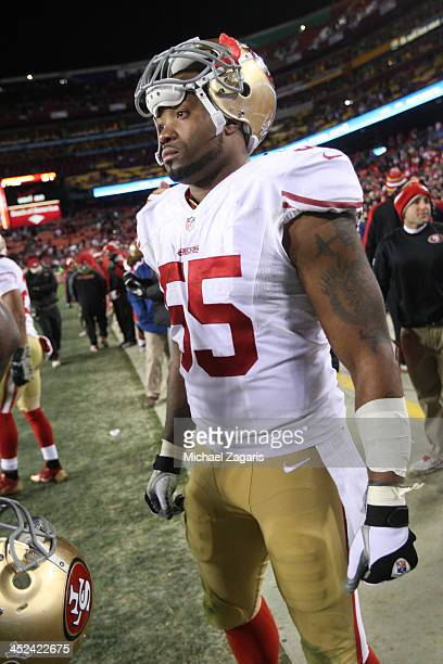 Ahmad Brooks of the San Francisco 49ers stands on the sideline during the game against the Washington Redskins at FedEx Field on November 25 2013 in...