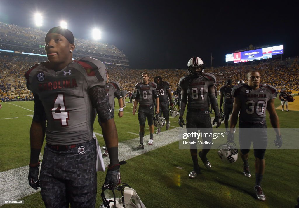 Ahmad Christian of the South Carolina Gamecocks walks off the field after a 2321 loss against the LSU Tigers at Tiger Stadium on October 13 2012 in...