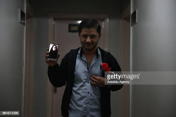 Ahmad Darvish shows a photo of his fiancee from his mobile phone in Gaziantep Turkey on October 20 2017 Eight Syrian teenagers forced to be separated...