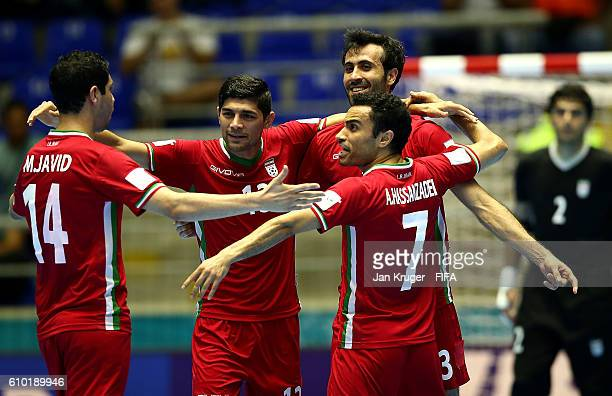 Ahmad Esmaeilpour of Iran celebrates his goal with team mates during the FIFA Futsal World Cup quarter final match between Paraguay and Iran at...