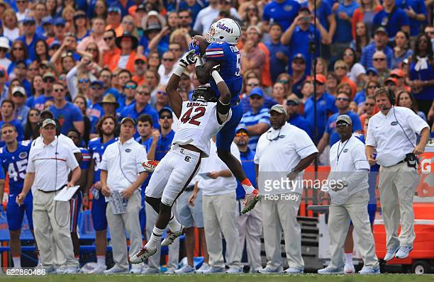 Ahmad Fuelwood of the Florida Gators makes a catch over Jordan Diggs of the South Carolina Gamecocks as head coach Jim McElwain of the Florida Gators...