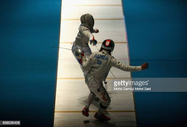 Ahmad Huzaifah Saharudin of Singapore competes against Thong Tangchin of Cambodia during the Men's Sabre Individual fencing match at the 2017 SEA...
