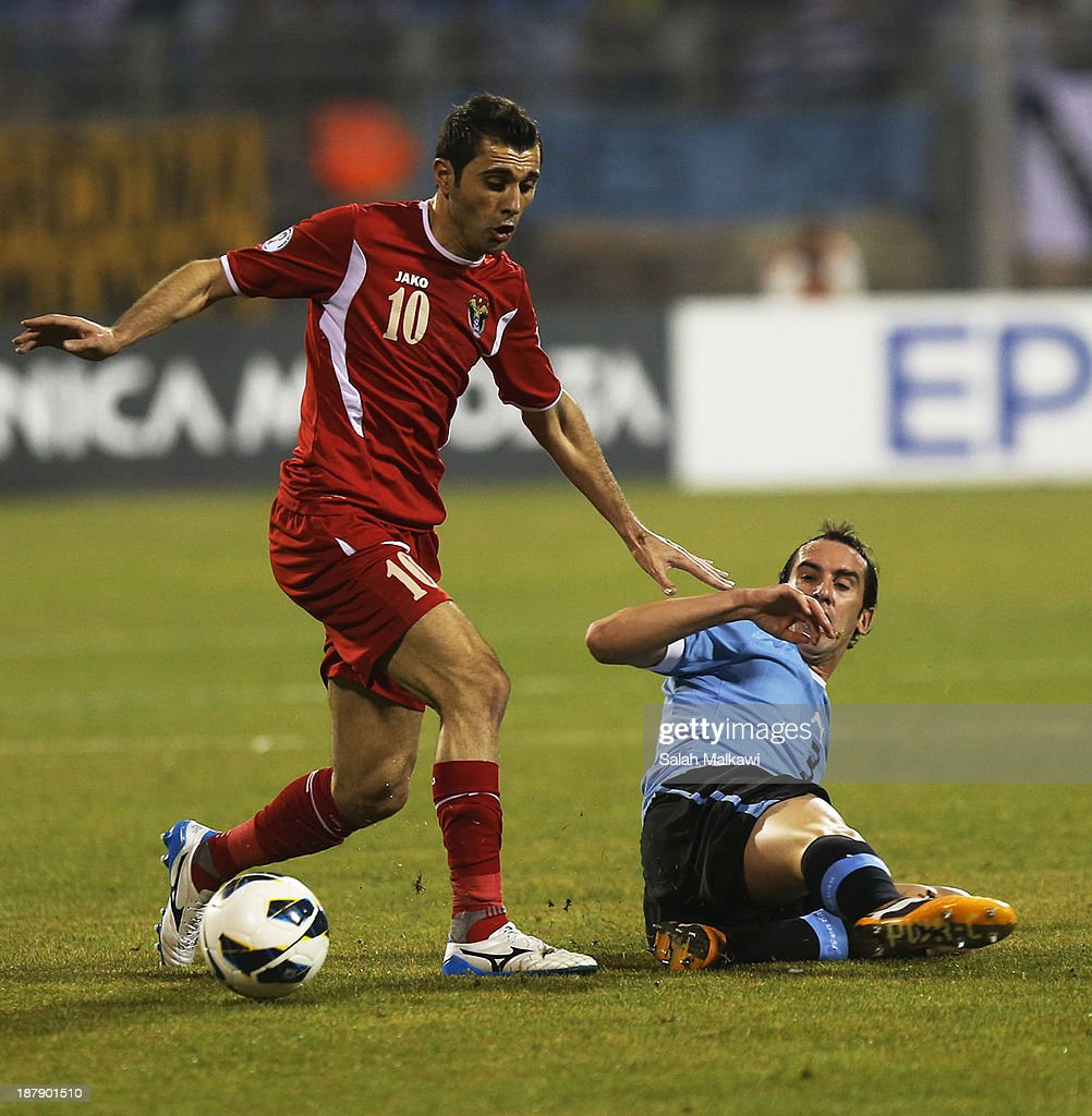 Ahmad Ibrahim Hayel fights for the ball during the FIFA 2014 World Cup Qualifier: Intercontinental Play-off First Leg between Jordan and Uruguay on November 13, 2013 in Amman, Jordan.