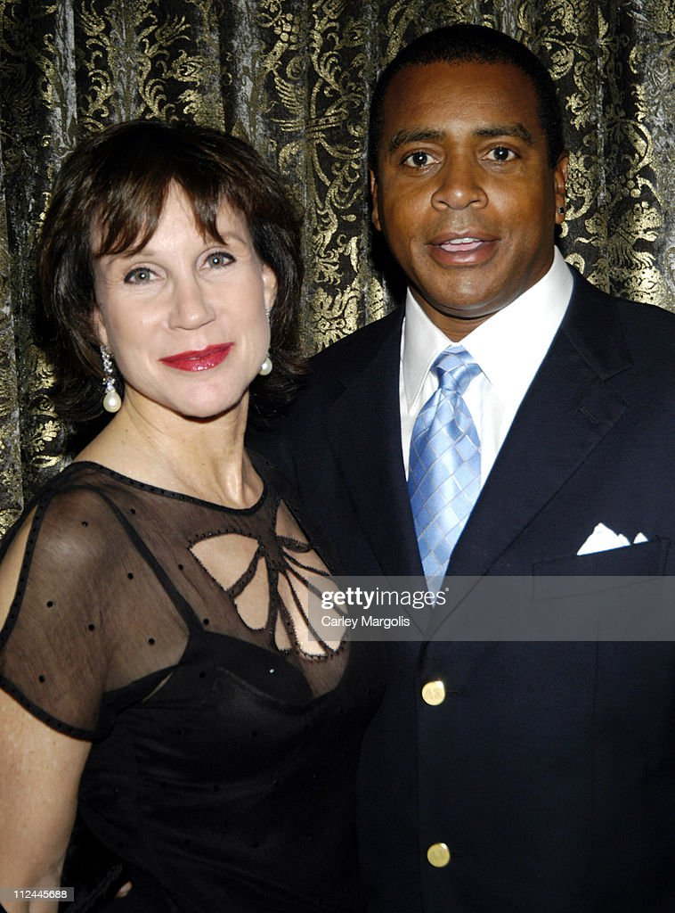 <a gi-track='captionPersonalityLinkClicked' href=/galleries/search?phrase=Ahmad+Rashad&family=editorial&specificpeople=228301 ng-click='$event.stopPropagation()'>Ahmad Rashad</a> (right) and guest during The Associates Committee of The Society of Memorial Sloan-Kettering Cancer Center Host 'A Wynning Hand' at Sotheby's in New York City, New York, United States.