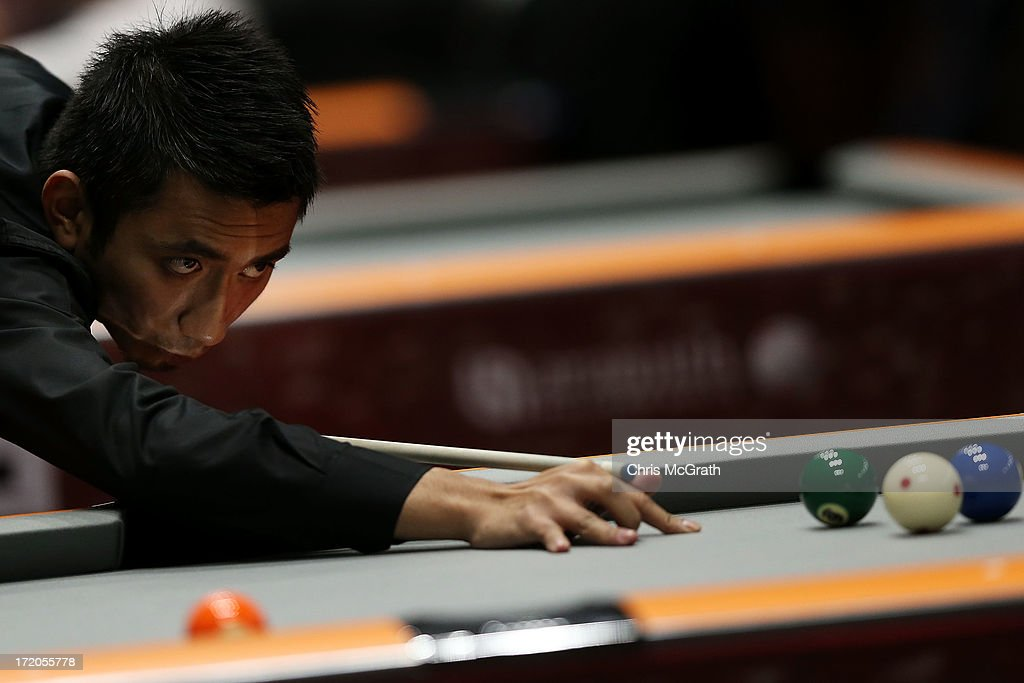 Ahmad Taufiq Bin M Murni of Brunei plays a shot against Li Hewen of China during their Billiards, Men's 9 Ball Single Quarterfinals match at Songdo Convensia on day three of the 4th Asian Indoor & Martial Arts Games on July 1, 2013 in Incheon, South Korea.