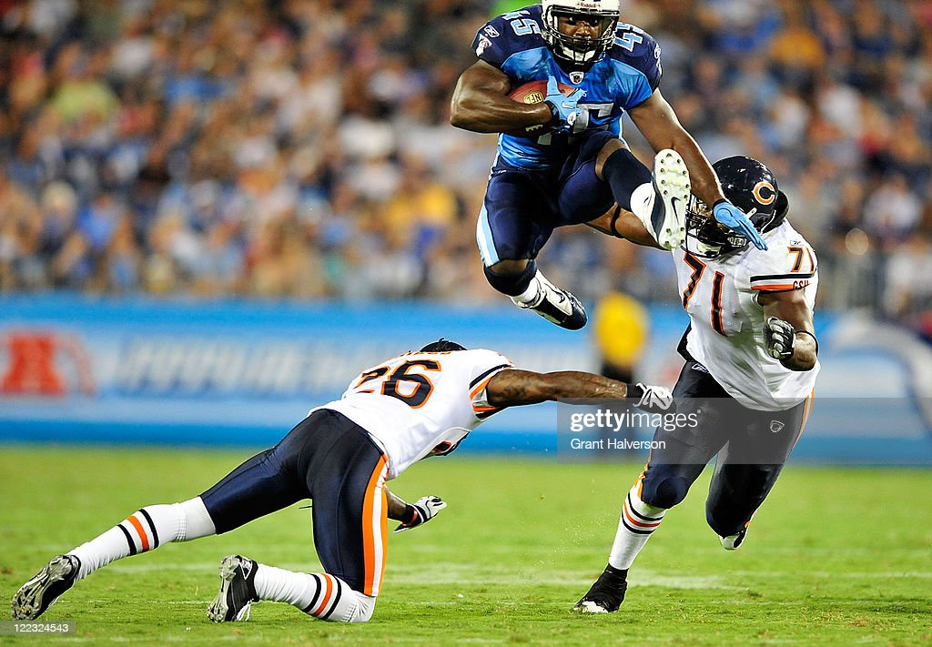 Ahmard Hall #45 of the Tennessee Titans hurdles <a gi-track='captionPersonalityLinkClicked' href=/galleries/search?phrase=Tim+Jennings&family=editorial&specificpeople=2081449 ng-click='$event.stopPropagation()'>Tim Jennings</a> #26 and <a gi-track='captionPersonalityLinkClicked' href=/galleries/search?phrase=Israel+Idonije&family=editorial&specificpeople=589818 ng-click='$event.stopPropagation()'>Israel Idonije</a> #71 of the Chicago Bears during a preseason game at LP Field on August 27, 2011 in Nashville, Tennessee.