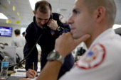Ahmed Abousaleh of FEMA and Maikel Garcia of the City of Miami Fire Rescue take part in the annual Hurricane Emergency Operations Center functional...