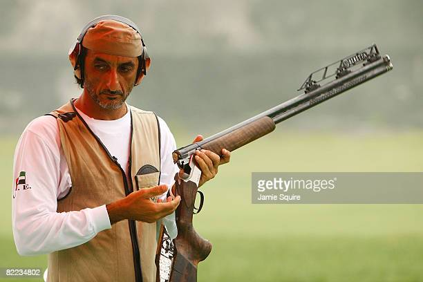 Ahmed Almaktoum of the United Arab Emirates competes in men's trap qualification shooting event held at the Beijing Shooting Range Hall during Day 2...